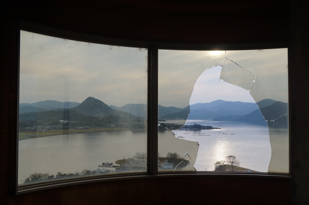 Hotel Haikyo Japan, View of Kumihama Bay, Broken Window