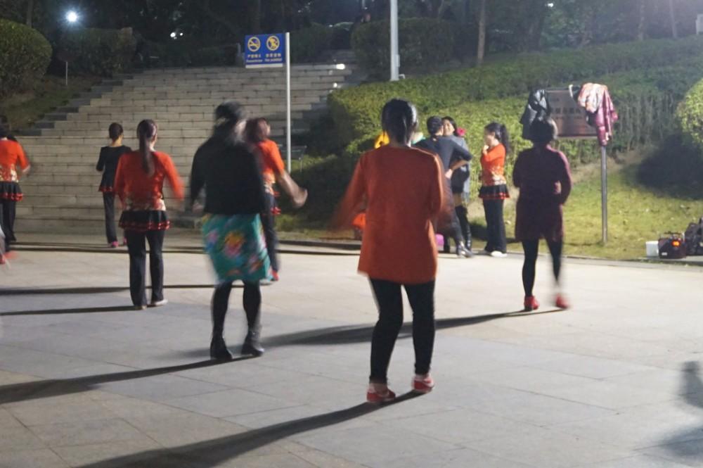 Women dancing in a park in Guangzhou at night